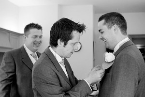 ushers fitting buttonholes