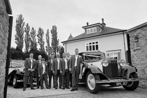 groomsmen with car