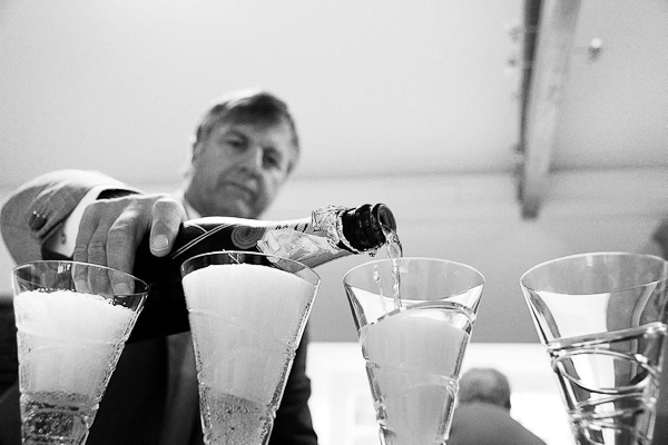 father of bride pouring champagne