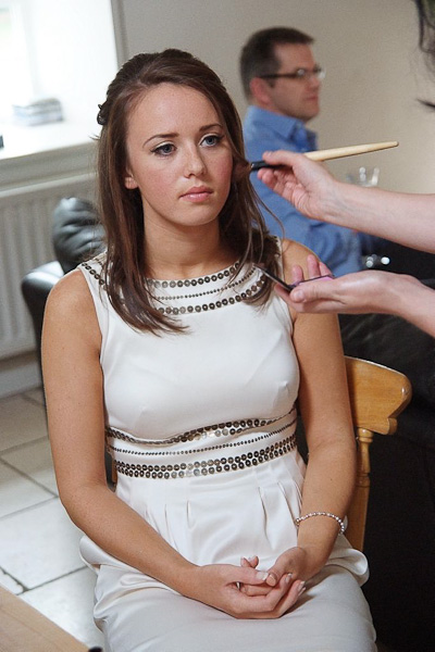 bridesmaid having makeup applied