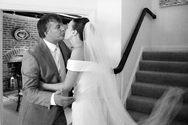 bride kissing father of the bride