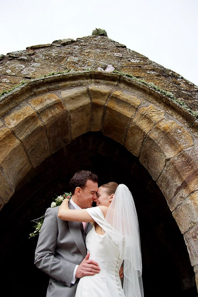 bride and groom at st michaels all angels church felton