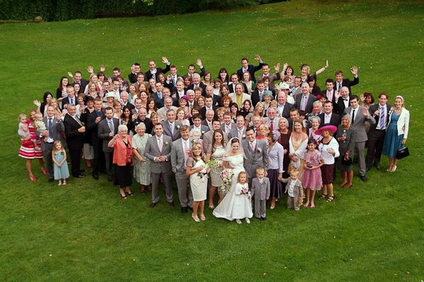 group photograph at ellingham hall wedding