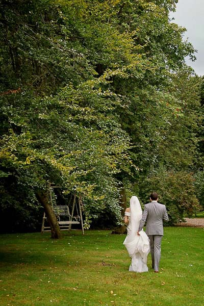 bride and groom walking at ellingham hall