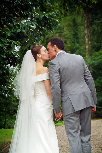 bride and groom kissing at ellingham hall wedding