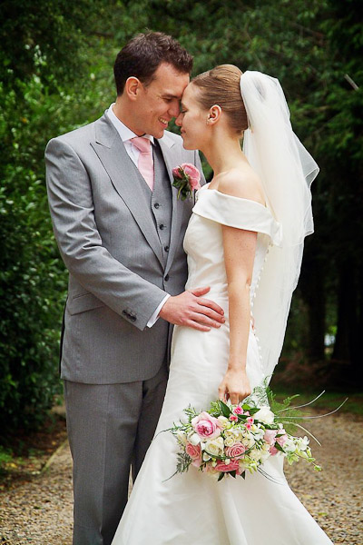 bride and groom looking at each other at ellingham hall wedding