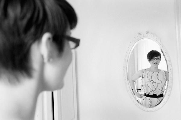 portrait of bridesmaid looking in mirror