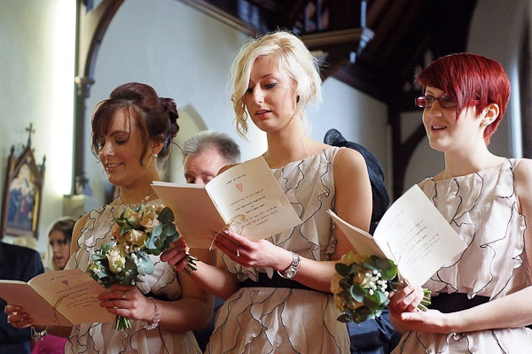 bridemaids singing in church