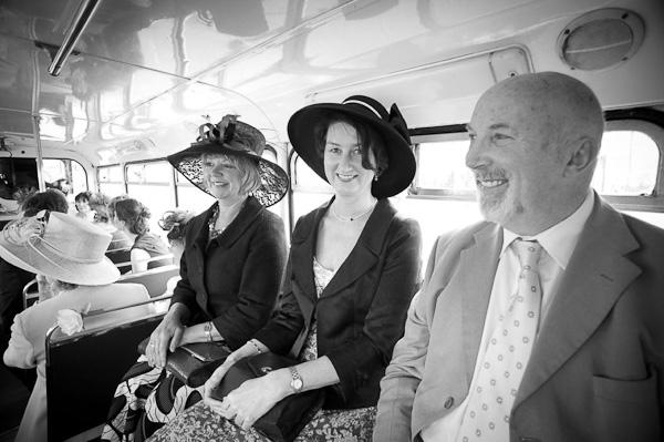 guests on vintage wedding bus