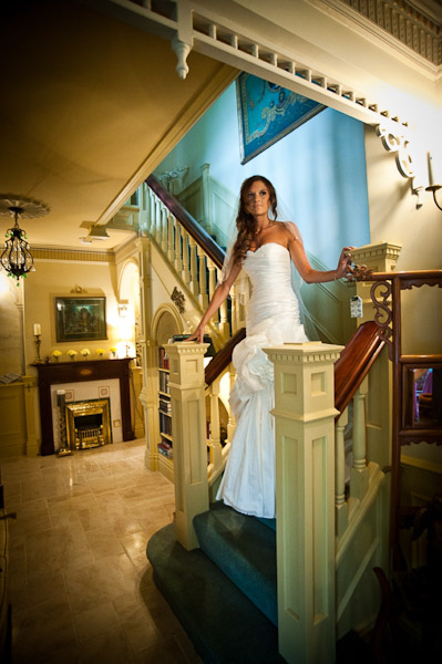 bride on stairs rockliffe hall wedding