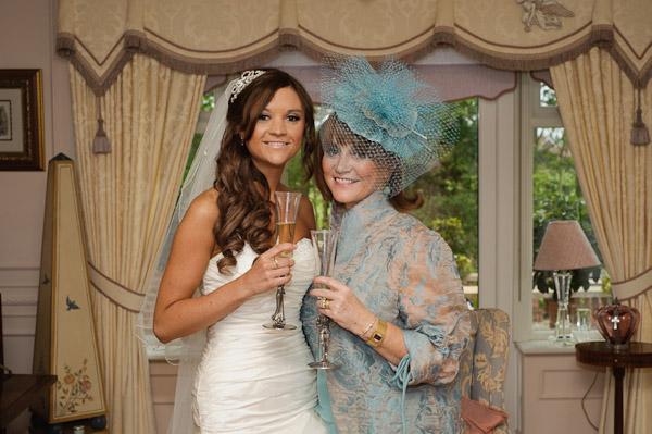 bride and mum smiling at wedding