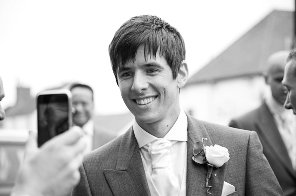 groom laughing at church
