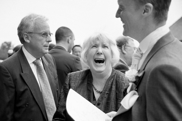 guests laughing at church wedding