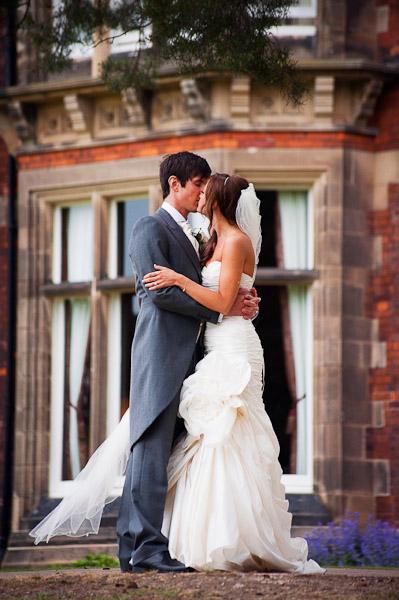 bride and groom kissing at rockliffe hall wedding