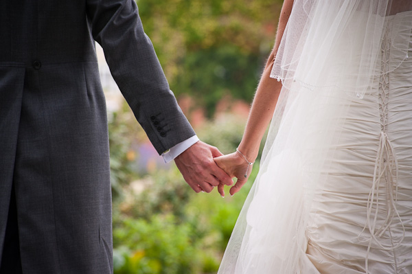 bride and groom holding hands rockliffe hall wedding