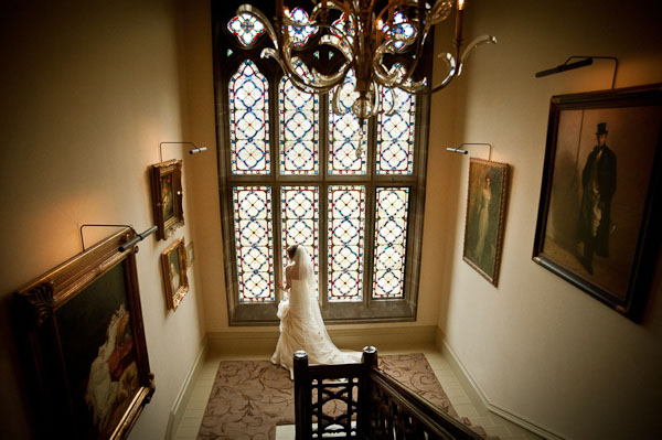 bride in front of stained glass window rockliffe hall wedding