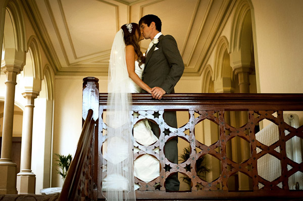bride and groom kiss on stairs rockliffe hall wedding
