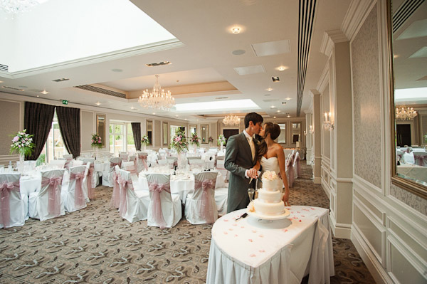 bride and groom cutting cake rockliffe hall wedding