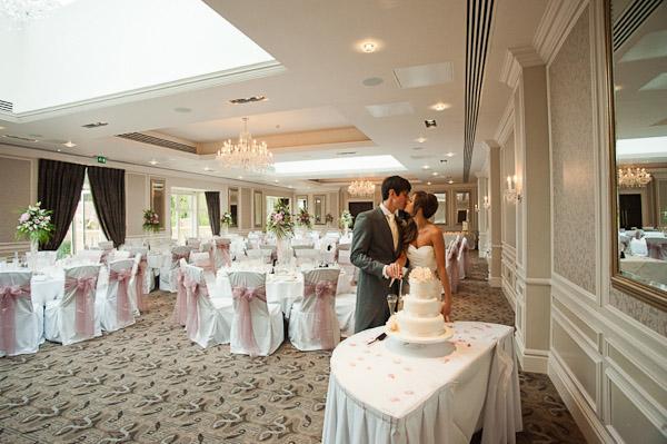 bride and groom cutting cake rockliffe hall wedding