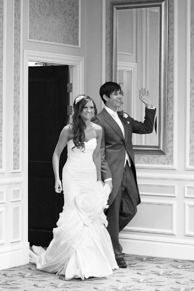 bride and groom entering room rockliffe hall reception