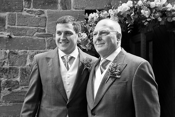 groom and dad outside church of our lady in seaton delaval