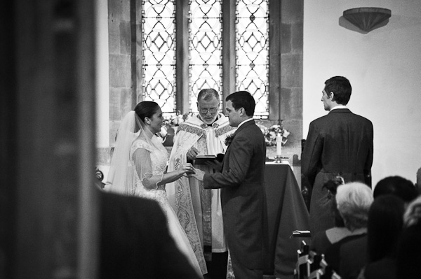 exchanging rings at seaton delaval hall wedding ceremony