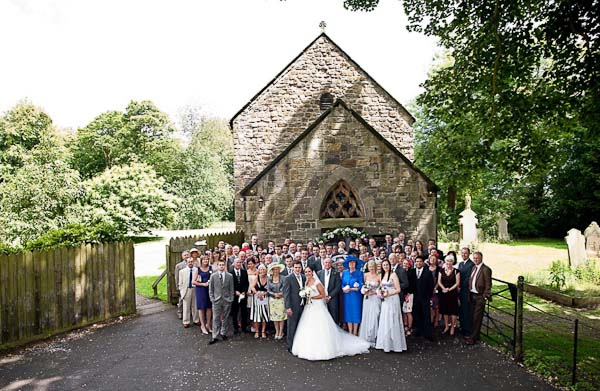 group photograph of all guests at seaton delaval hall wedding