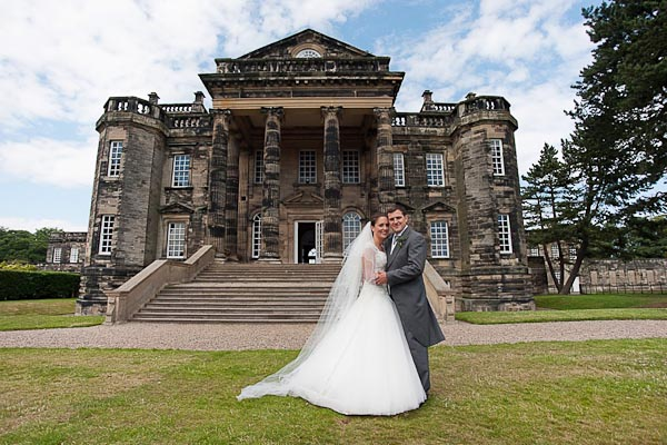 seaton delaval hall wedding photography bride and groom outside hall