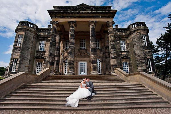 bride and groom outside seaton delaval hall