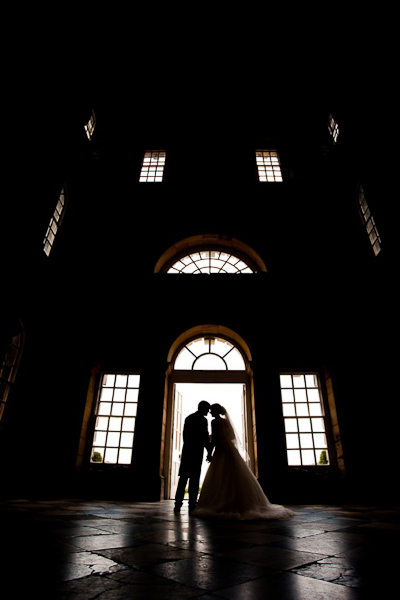silhouette of bride and groom from seaton delaval hall wedding photos