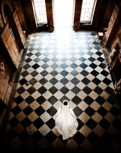 bride walking in seaton delaval hall