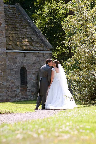 bride and groom kissing at seaton delaval hall wedding