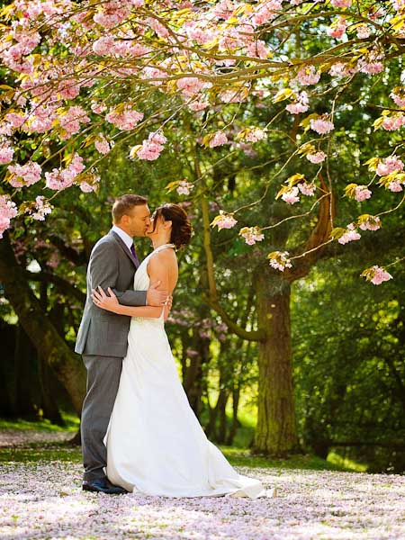 bride and groom under blossom tree crab and lobster wedding photographer