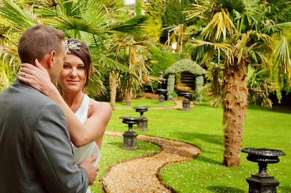 crab and lobster wedding photographer bride and groom with palm trees