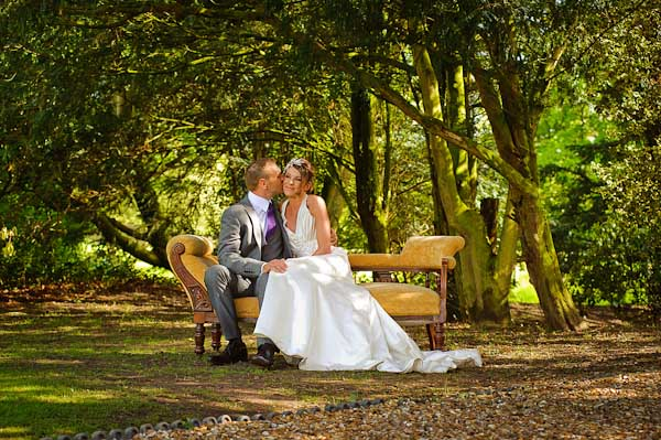 crab and lobster wedding photographer bride and groom sat on chaise longue