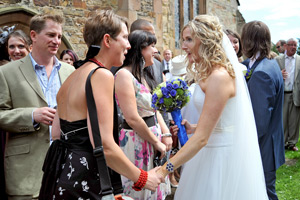 bride greeting guests at wynyard church