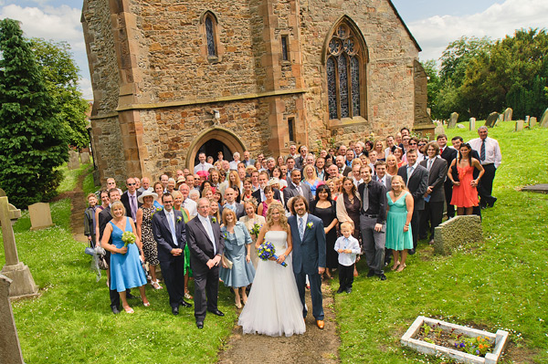group photo of all guests outside church