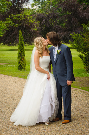Wynyard Hall Wedding Photography bride and groom kissing in walled garden