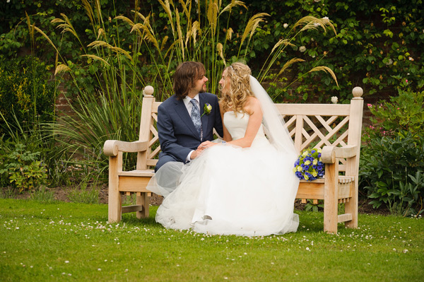 Wynyard Hall Wedding Photography bride and groom sat on bench together