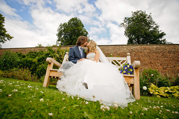 Wynyard Hall Wedding Photography bride and groom kissing on bench