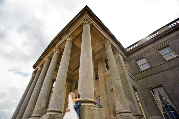 Wynyard Hall Wedding Photography bride and groom leaning on pillars