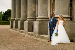 Wynyard Hall Wedding Photography bride and groom casually leaning on pillars