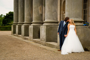 Wynyard Hall Wedding Photography bride and groom kiss next to pillars