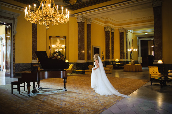 Wynyard Hall Wedding Photographer bride walking in great hall at wynyard