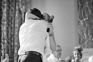 bride and groom hugging in speeches