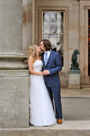 bride and groom kissing outside wynyard hall