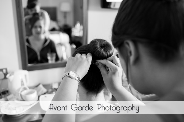 bridesmaid having hair done ready for wedding