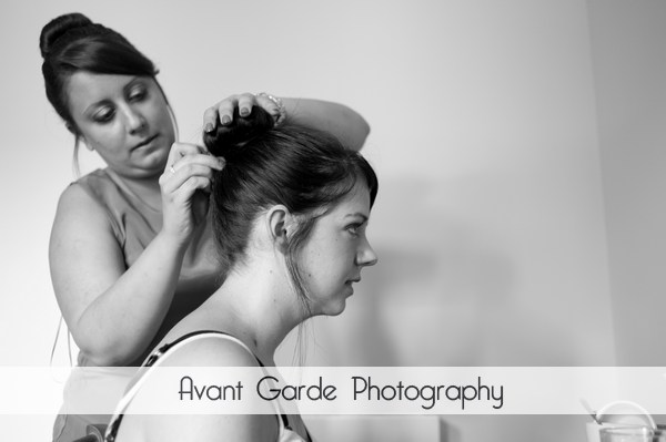bridesmaids hair being done for wedding