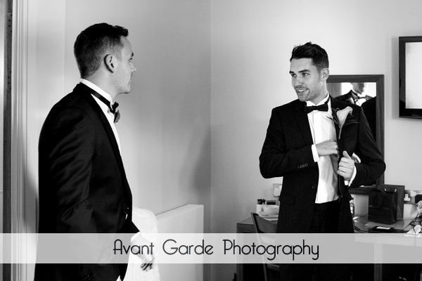 Best man and groom wearing tuxedos getting ready for Alnwick Castle wedding