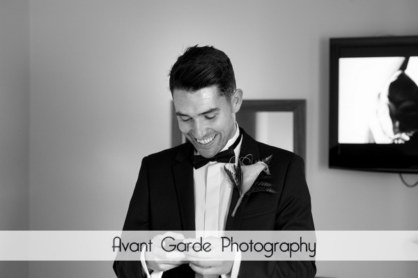 Groom in tuxedo getting ready for wedding at Alnwick Castle